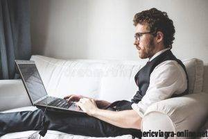 elegant-attractive-fashion-hipster-man-using-notebook-home-34296779